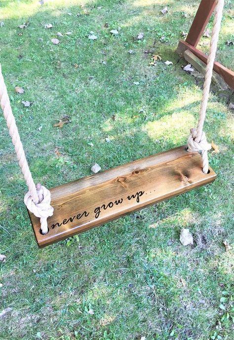 Never Grow Up Wooden Rope Swing Dark Wood Tree Swing Etsy Tree House Diy Outdoor Wooden Swing Wood Tree Swing