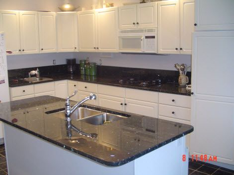 Blue pearl or emerald pearl with white cabinets granite for White kitchen cabinets with blue pearl granite