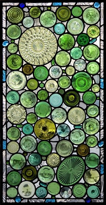 "This ""Green Bottoms"" window is installed in a lovely home on Simmons Island, GA. To personalize the window, the client requested the inclusion of ""sea glass"" they found at the local beach. The addition of greenish blue plate fragments and jewels in the border give the window's color range an ocean feel."