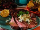 Bobby Flay's grilled rib eyes with goat cheese and Meyer lemon sauce