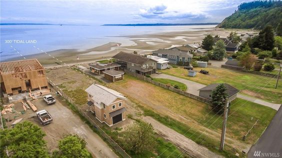 What a shame how this has been built up. That tiny 566 sq ft shingle style cottage is $1.5 million.