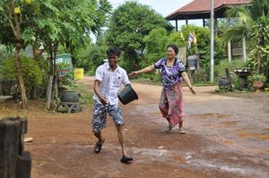 Songkran in NE Thailand my brother-in-law being chased by our next door neighbour.  Songkran is a lovely time when we all get wet.  #painting #holiday #thailand jeremyholton.com Visit our art and photography guest house in NE Thailand thailand-painting-holidays.com by Jeremy Holton