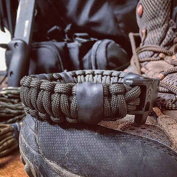 #Repost @survivor_town ・・・ My @superessestraps survival bracelet resting on my hiking boots. What's the farthest you've hiked with your BOB?