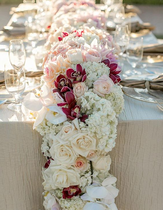 K'Mich Weddings - wedding planning - centerpiece alternatives - floral runner - Pair darling pink tones, like fuchsia and blush, to create a reception table runner fit for a princess- - wilkie blog