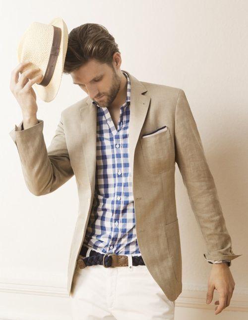 Tan sport coat large blue gingham khakis. This man reminds me of