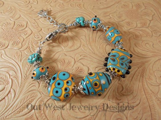 Hand Torched Chunky Lampwork Bead Bracelet Aqua and Orange with Turquoise Nuggets No. 41 by Outwestjewelry on Etsy https://www.etsy.com/listing/182361158/hand-torched-chunky-lampwork-bead