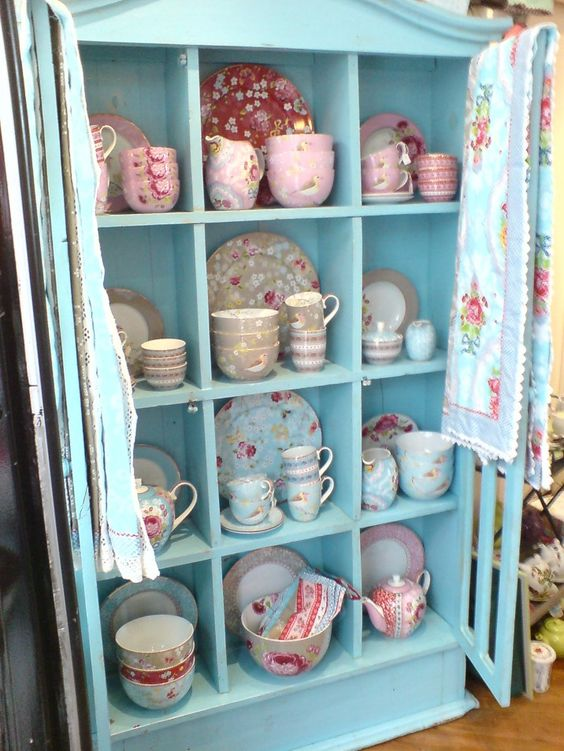 I love this sweet cupboard ~ darling cups and plates.  love that color!  Thanks for making me smile, Francis!