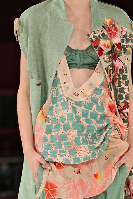 Kenzo Spring 2011.  This is a beautiful combinations of color and mixed fabric print!