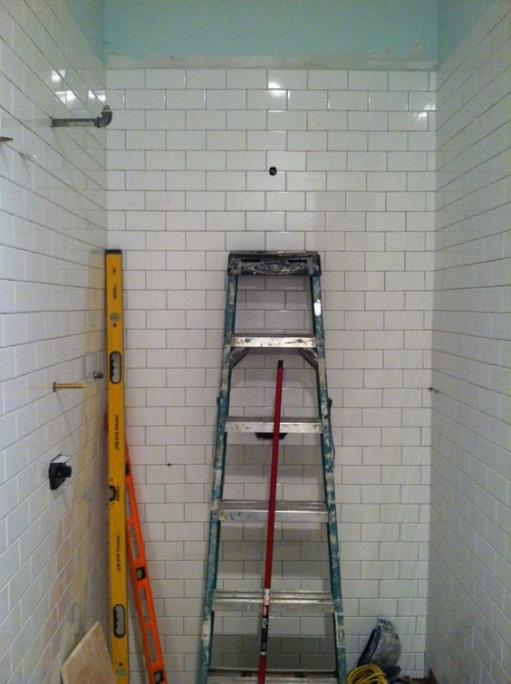 My thought for my small bath, but with the subway tiles going vertical.