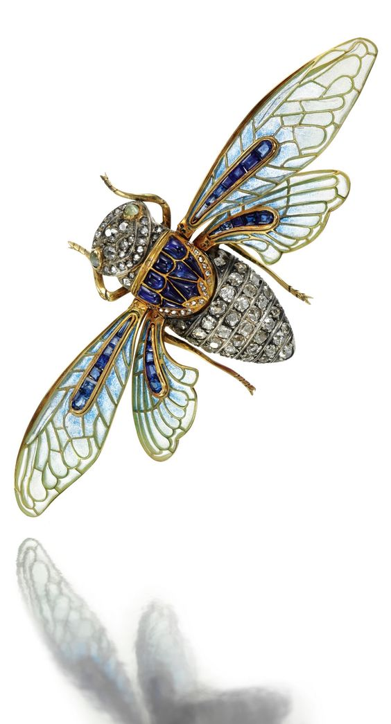A BELLE EPOQUE GOLD, ENAMEL, GEM-SET AND DIAMOND BROOCH, BOUCHERON, CIRCA 1890. Designed as a cicada, the articulated wings decorated with plique-à-jour enamel and calibré-cut sapphires, the abdomen and head set with cushion-shaped, circular-cut and rose diamonds, further set with buff top sapphires, the eyes of cabochon cat's-eye chrysoberyl, French assay marks and maker's marks for Frédéric Boucheron. #Boucheron