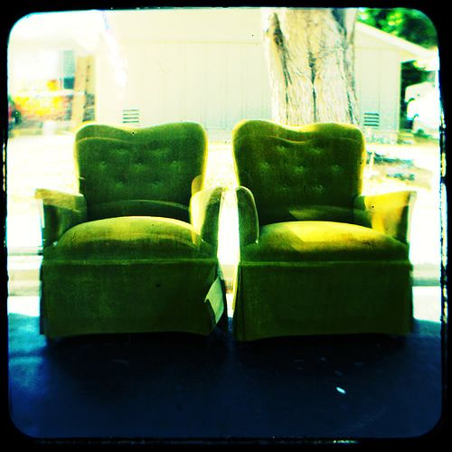 pretty green tufted chairs