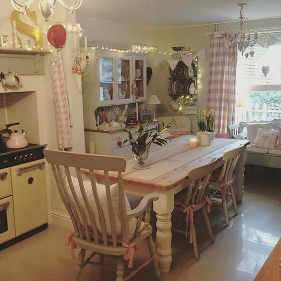 Cooking dinner ... #myhome #shabbychic #countryliving #farmhousetable#lilys#candles#bunting #fairylights #kitchen #dresser #vintage #cornwall