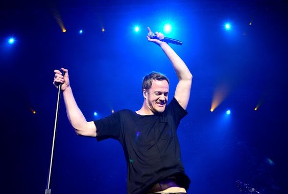 "Imagine Dragons' Dan Reynolds is ""On Top Of The World"" during a performance on Nov. 25 in London"