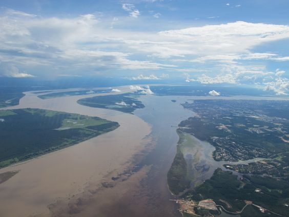 The meeting of the Rio Negro and Rio Solimões, where the Amazon forms, Manaus, Brazil.