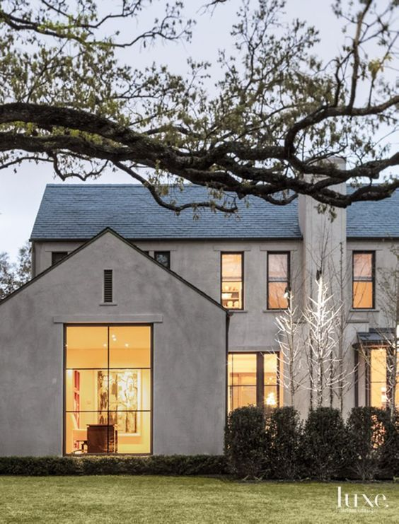Smooth troweled cement plaster and a slate roof define the for Exterior definition