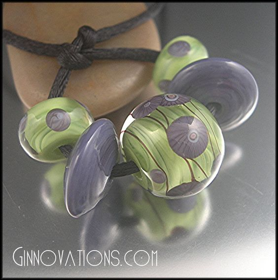 Springtime Blooms is a brightly colored set of 5 beads (created by me!) made with Italian Effetre glass in streaky lime green, bold grape purple, a touch of soft black, and crystal clear.  You will receive one encased focal bead, a pair of tapered disc-shaped beads and a matching pair of petite decorated beads, maybe for earrings!