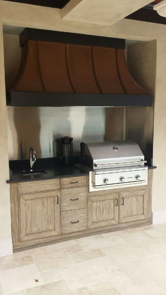 Small And Beautiful Naturekast Outdoor Kitchen With Delta Heat Grill And Custom Vent A Hood