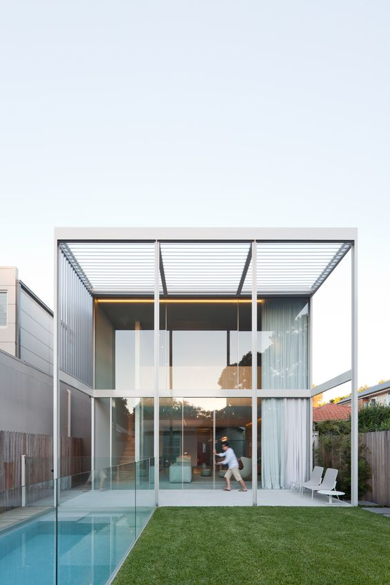 Double height sliding doors open up the rear of this Randwick property to northern  light and breeze. The entire rear wall of the property measures in at 6.7H x 7.2W with the top section of the doors being motorised to create a breezeway while the sliding doors at ground level create an uninterrupted connection to the outside garden. Architects: Studio Internationale
