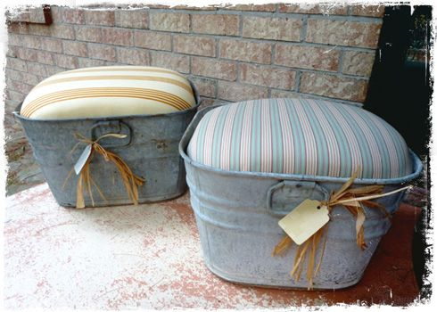 Cute little tin ottomans....................................  This would be cute with the right décor.  I have an old wash tub that belonged to my mother-in-law.  Have used it for flowers, but this is a cute idea if it would work for someone.  Mine is round. My mother's were this shape.