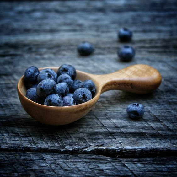 Hand carved maple Chef's Scoop with blueberries on rustic wood background. Moody food photography. Old World Kitchen by Polder's Old World Market. www.oldworldlivingblog.com