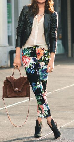 Black leather jacket or vest, white button up or white top, floral pants