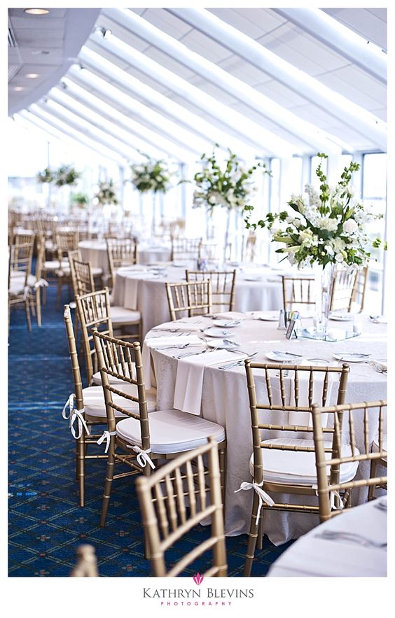 Harbor Room with gold chairs and tall centerpeices at Town Point Club, Norfolk Va
