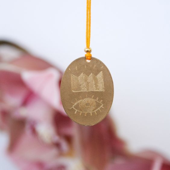 Hand engraved brass tag on Chinese silk thread with small brass bead.Handmade in New Zealand, one of a kind.Total length 75cm.