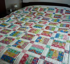 Jelly Roll Quilt - the white sashing and colored cornerstones make this a standout quilt.