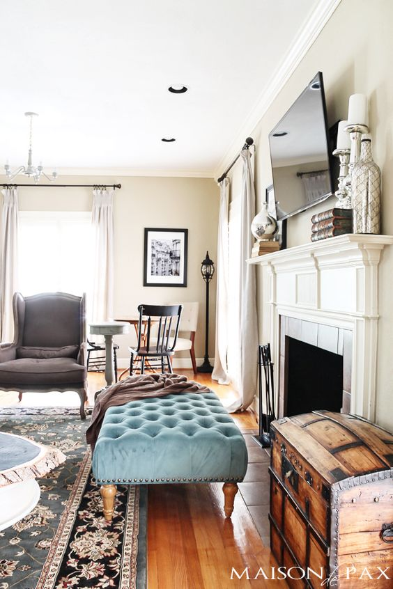 Rustic chic living room turquoise fireplaces and ottomans for Extra living room ideas