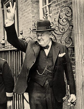 "Churchill making his famous ""V for victory"" sign in 1943.:"