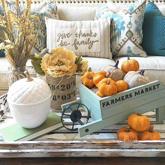 Love this styling of this autumn vignette with the acorn and small wheelbarrow :: See this Instagram photo by @thedowntownaly