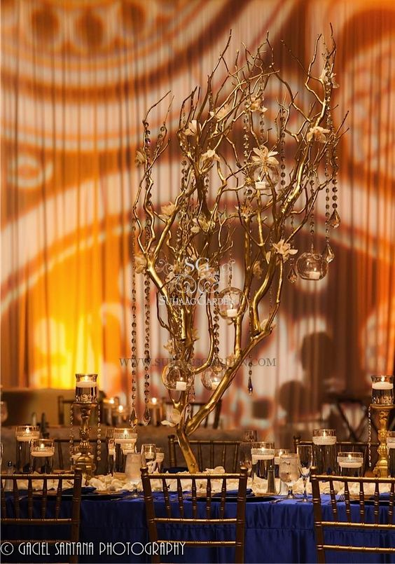 Tall Manzanita Branches, Hanging Glass Globes, Amber Lighting, Sapphire Linen, Suhaag Garden, Indian Wedding Decorator, Lots of Candles, Cymbidium Orchids