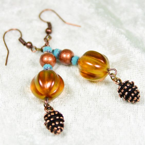 You'll be pretty as a pinecone wearing these playful copper drop earrings. Each…