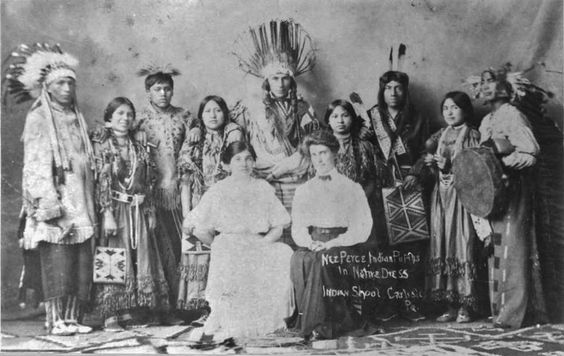 Nez Perce graduates from the Carlisle Indian Industrial School in Carlisle, Pennsylvania, including Elizabeth Penny, (sitting on the left) and Harry Wheeler (standing far right), visiting the Cleveland Institute of Art in Cleveland, Ohio - 1909