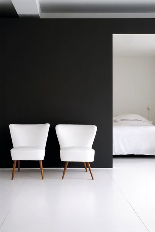 Black and White, black wall, white floor, white chairs