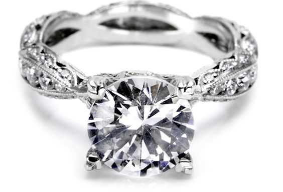 This one is gorgeous! Kind of simple and elegant. I like the band and yet it doesn't draw attention away from the diamond in the center. This one might just be my favorite one!