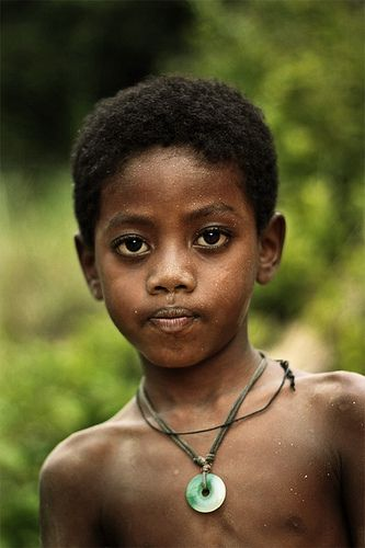 A young boy from a group of peoples indigenous to Malaysia ...