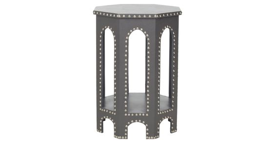 Make a bold statement on a small scale: this architectural, Moroccan-style table is trimmed in stainless steel nail heads and finished in chic gray.