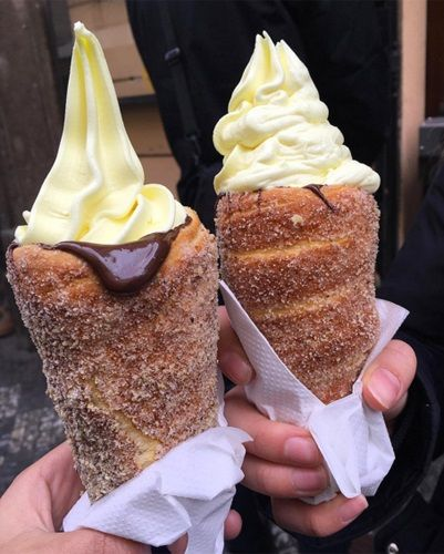 Cinnamon-sugar doughnut ice cream cones, lined with Nutella, from Prague's Good Food Coffee and Bakery. Cinnamon-sugar -  A riff on trdelníks, a traditional Czech pastry made from grilled dough #sweettreats...x