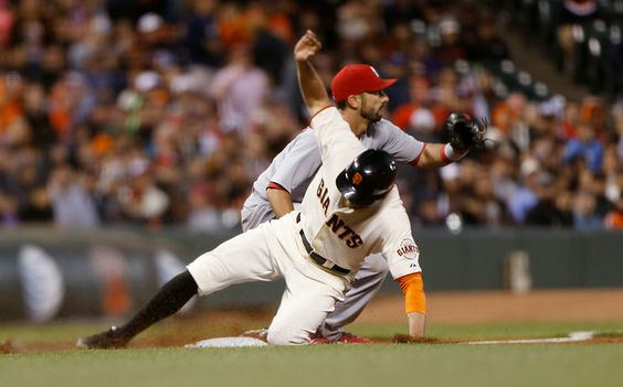 San Francisco Giants' Hunter Pence (8) slides to third base against the St. Louis Cardinals in the fifth inning at AT&T Park in San Francisco, Calif., on Tuesday, July 1, 2014. (Josie Lepe/Bay Area News Group)