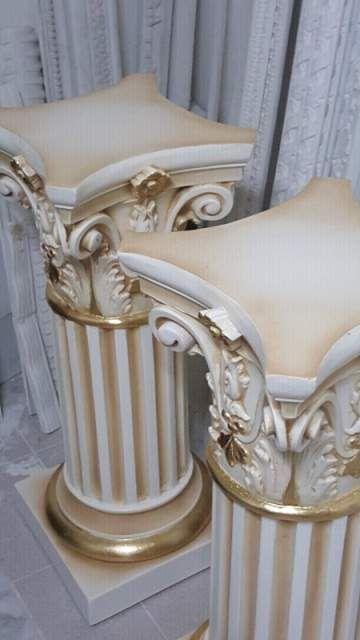 Coppia di colonne panna e oro foglia