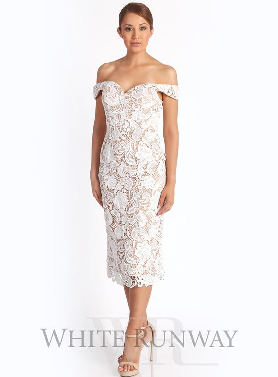 Stella Dress by Love Honor. Stunning lace dress by Australian designer Love Honor. A flattering midi dress with a sweetheart neckline, corset bodice and draped off-shoulder sleeves. Available in Black/Nude, Navy/Nude and Ivory/Nude. Scooped sweetheart neckline