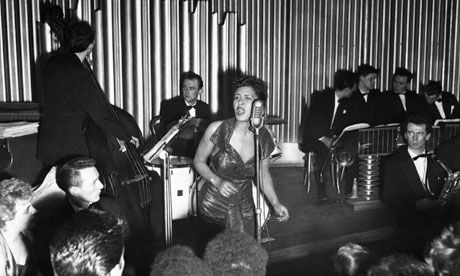 Billie Holiday in concert in Britain, 1954. Her later performances of Strange Fruit could be agonising to watch. Photograph: Charles H Hewit...
