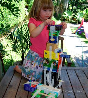 Building the Eiffel Tower with boxes... awesome way to use recycled materials.