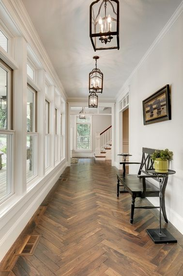 Herringbone wood floor -- Divine Custom Homes foyer via Houzz.com. Flooring options narrowed down to 2 options.