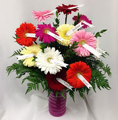 Vase of Daisies : http://www.lougheedflowers.com/product/vase-of-daisies/