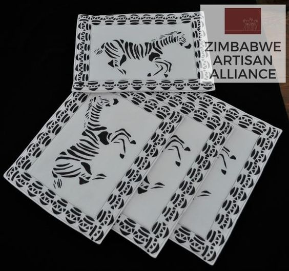 """Black and White Zebra Print Placemats"" Zimbabwe Textiles Set of 4 hand printed African placemats.  These placemats are hand printed by Zimbabwean women who work from  home. Their wares are then sold at the Avondale Market in Harare, Zimbabwe.  This set was made by the artist Patricia."