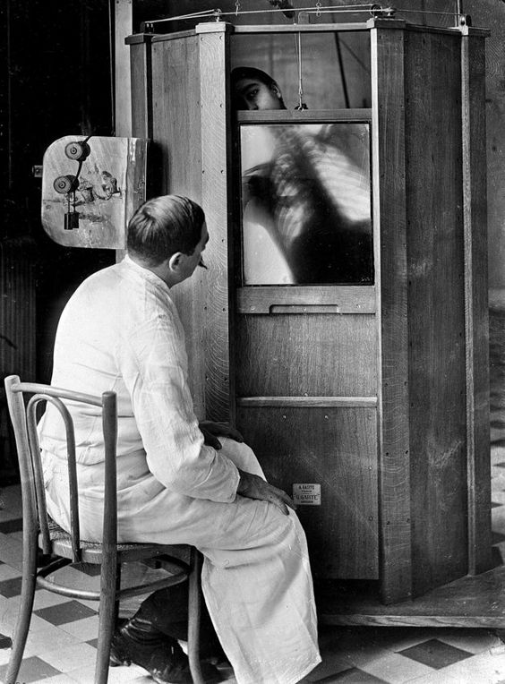 A chest X-ray in progress at Dr. Maxime Menard's radiology department at the Cochin hospital in Paris, circa 1914. Mendard would later lose his finger to side effects from operating the X-ray machine. - 27 Crazy Images Of Medical Treatments Through History