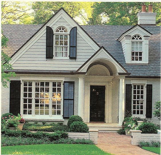 Painted brick shutters barrel vaulted front porch for Houses with dormers and front porch