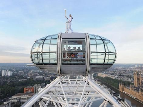 """The Olympic Torch on the """"London Eye""""."""